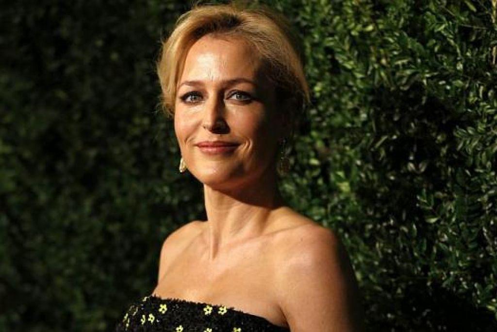 CUKUP POPULAR: Drama bersiri The X-Files ini lakonan David Duchovny dan Gillian Anderson (gambar) cukup popular dahulu. - Foto-foto REUTERS dan TWENTIETH CENTURY FOX