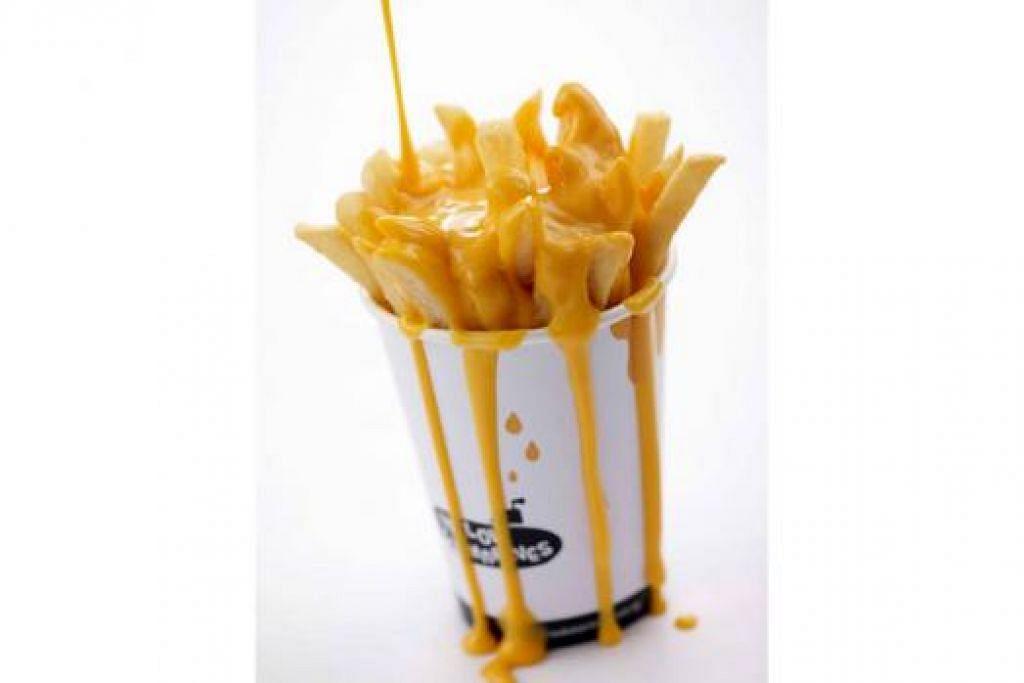 MENYELERAKAN: 'Torpedo Fries' kentang goreng tebal dicampur dengan keju. - Foto YELLOW SUBMARINES