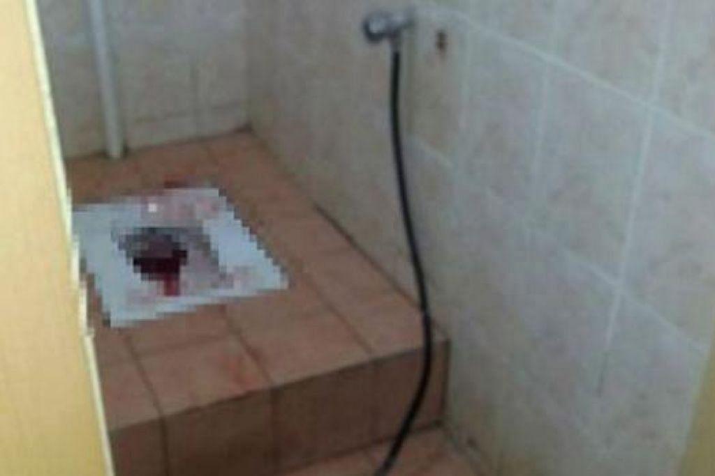 DITEMUI MATI: Mayat bayi berlumuran darah ditemui seorang kakitangan institusi pengajian tinggi yang mahu menggunakan tandas. Beliau kemudian menghubungi pihak berkuasa. - Foto NST