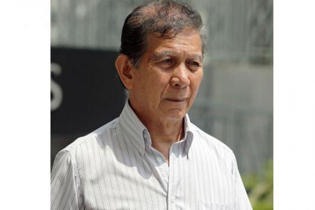 MOHAMED YUSOF: Hadapi 33 tuduhan menerima rasuah melibatkan $11,400 dan 103 tuduhan bersubahat dengan empat lelaki membuat pernyataan palsu melibatkan $493,858.67. – Foto THE STRAITS TIMES