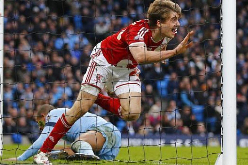 DIKEJUTKAN: Patrick Bamford meraikan gol jaringannya yang membantu Middlesbrough menewaskan Manchester kelmarin. - Foto REUTERS