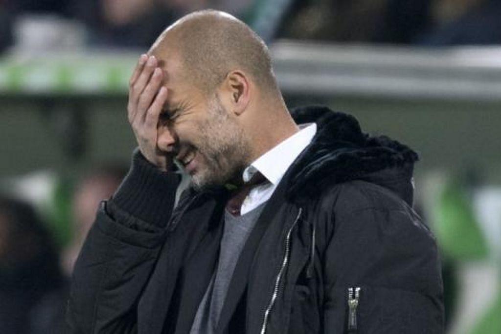 PENING: Jurulatih Bayern Munich, Pep Guardiola, tidak menduga pasukannya boleh dikejutkan Wolfsburg dengan kekalahan 1-4. - Foto REUTERS
