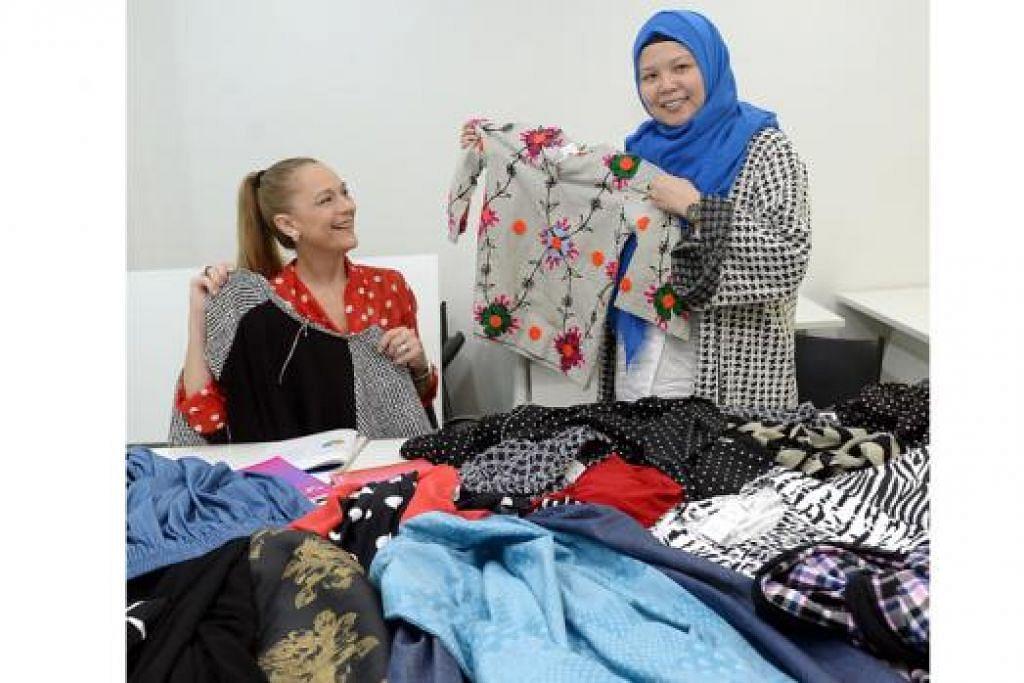 MEMPERLUASKAN PERNIAGAAN: Cik Aisha Aziz (kanan) banyak dibantu konsultannya, Cik Isabel Scherer, Pengarah Urusan Keyston Business Consulting, dalam membangunkan dan mengembangkan perniagaannya, termasuk dalam penggunaan e-dagangan. - Foto TAUFIK A. KADER