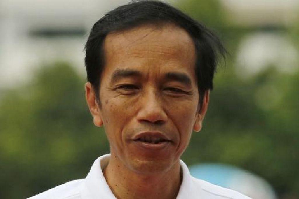 ENCIK JOKO WIDODO: Presiden Indonesia ini yakin negaranya boleh menikmati pertumbuhan ekonomi sebanyak 7 peratus. - Foto fail