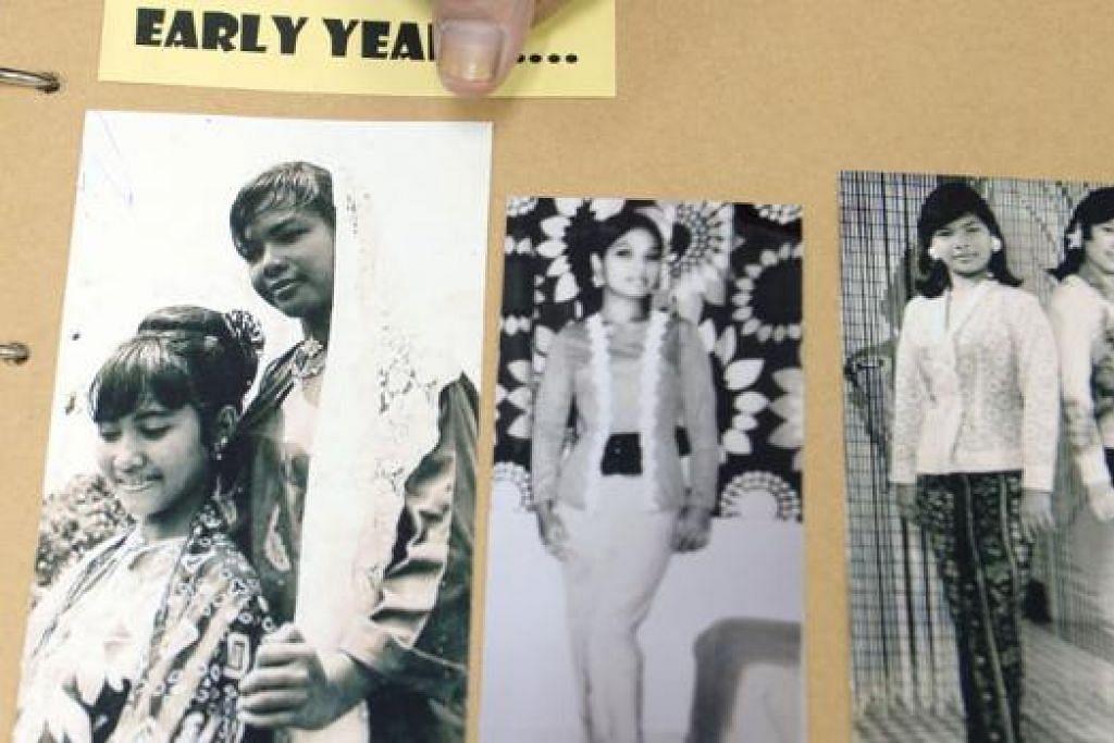 GAMBAR KENANGAN: Cik Som Said yang menceburi bidang seni tari pada usia remaja lagi menunjukkan gambar beliau sewaktu muda.