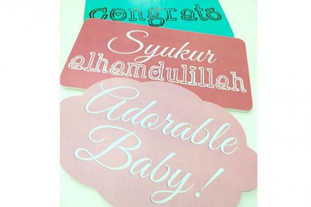 SLOGAN UNTUK MAJLIS CUKUR RAMBUT: Antara slogan yang sering digunakan untuk majlis cukur rambut termasuk 'Alhamdulillah' dan 'Adorable Baby' atau bayi comel.