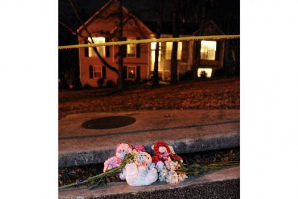 DI TEMPAT TERJADI PEMBUNUHAN: Seorang lelaki telah menembak tujuh orang di rumah di Douglasville, barat Atlanta, ini. Dua kanak-kanak cedera dalam tembakan tersebut. - Foto REUTERS