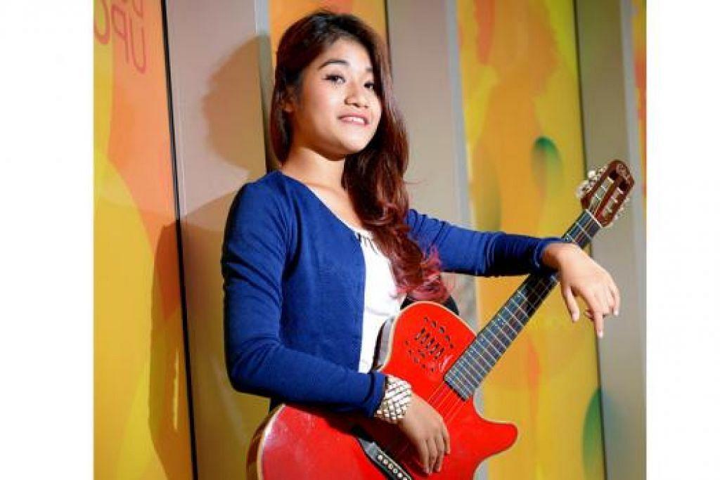BERBAKAT MAIN BERMACAM ALAT MUZIK: Bakat baru SRC, Qierra, boleh memetik gitar dan ukulele, meniup saksofon dan menggesek biola. - Foto TUKIMAN WARJI