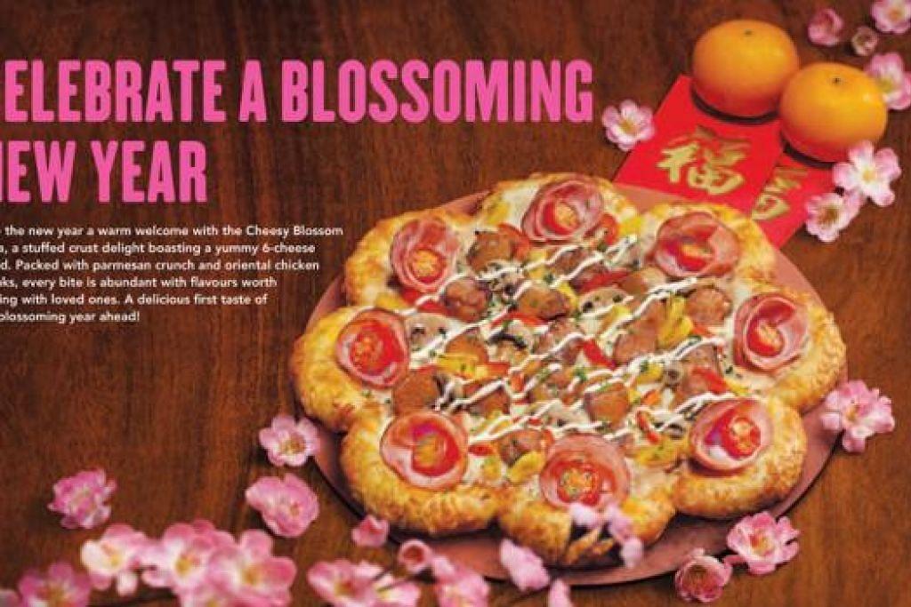 PIZA CHEESY BLOSSOM: Dihidangkan dengan doh lembut yang ditaburi keju parmesan dan enam jenis gabungan keju. – Foto PIZZA HUT