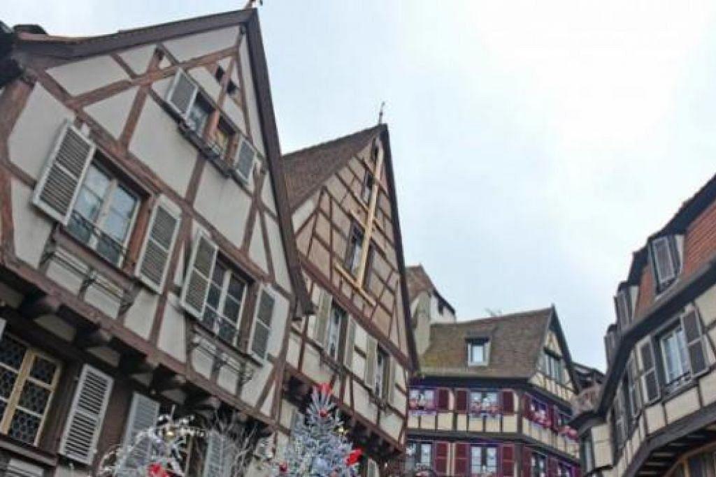 HAYATI REKA BENTUK BANGUNAN: Inilah rupa seni bina rumah di Colmar dan Strasbourg yang mempunyai pengaruh seni bina negara jiran, Jerman. - Foto-foto ihsan ZAKI ZULFAKAR NOORDIN