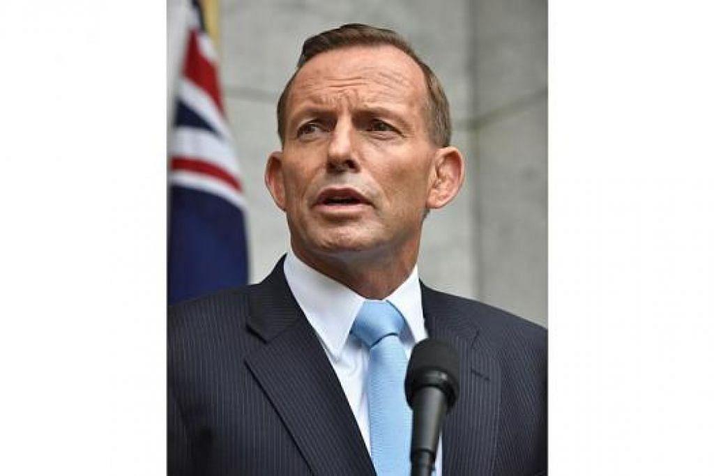 ENCIK TONY ABBOTT: Minta pemimpin Islam lakukan lebih banyak dalam memerangi fahaman pelampau. - Foto AFP