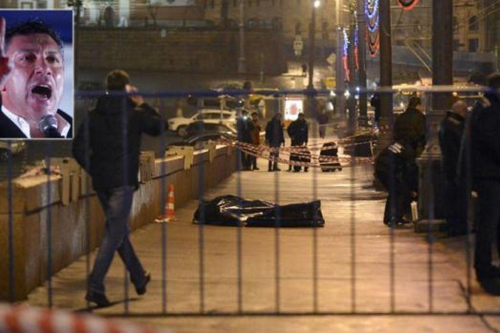 DITEMBAK BEBERAPA KALI: Mayat pemimpim pembangkang, Encik Boris Nemtsov, ditembak hingga lapan das dari sebuah kereta di jambatan Bolshoi. - Foto REUTERS