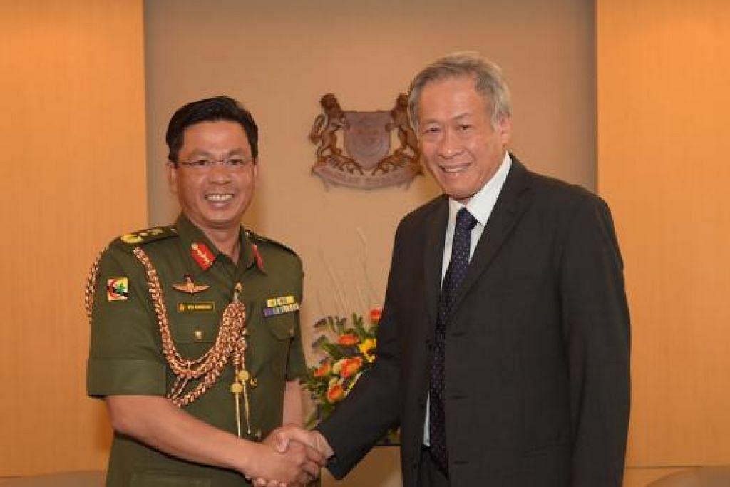 LAWATAN: Brigadier Jeneral (BG) Pengiran Dato Paduka Aminan (kiri) bersama Dr Ng. – Foto MINDEF