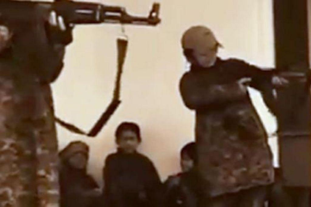 KANAK-KANAK JADI SASARAN: Klip video ISIS memaparkan kanak-kanak menjalani latihan ketenteraan. – Foto YOUTUBE