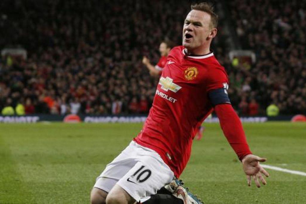 ROONEY: mengetuai pemain Manchester United dengan semangat tidak mahu kalah. Beliau juga bakal menjadi pengancam utama kepada benteng Liverpool jika diletakkan sebagai penyerang utama oleh pengurus Louis van Gaal. – Foto REUTERS