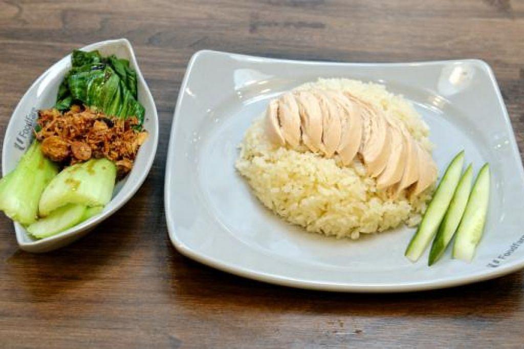 MENANTI DIIKTIRAF: Nasi ayam ini yang dijual di gerai Cik Siti Abibah, Kallang Wave Mall, sedang menanti pengiktirafan HPB sebagai pilihan lebih sihat.
