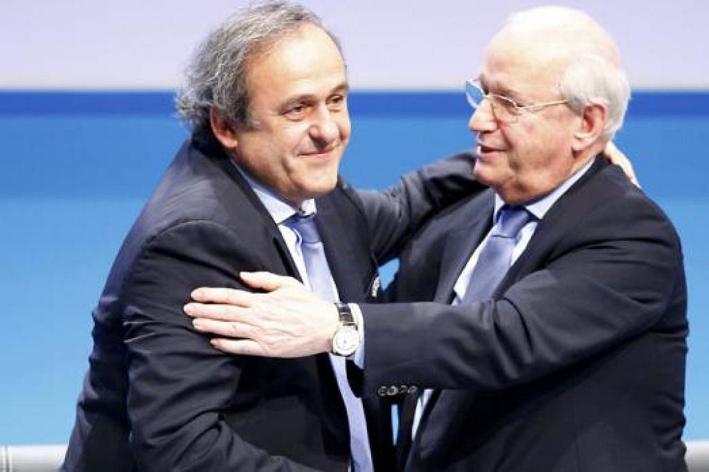 DILANTIK LAGI: Michel Platini (kiri) memuji badan bola sepak Eropah sebagai 'yang terbaik'. - Foto REUTERS