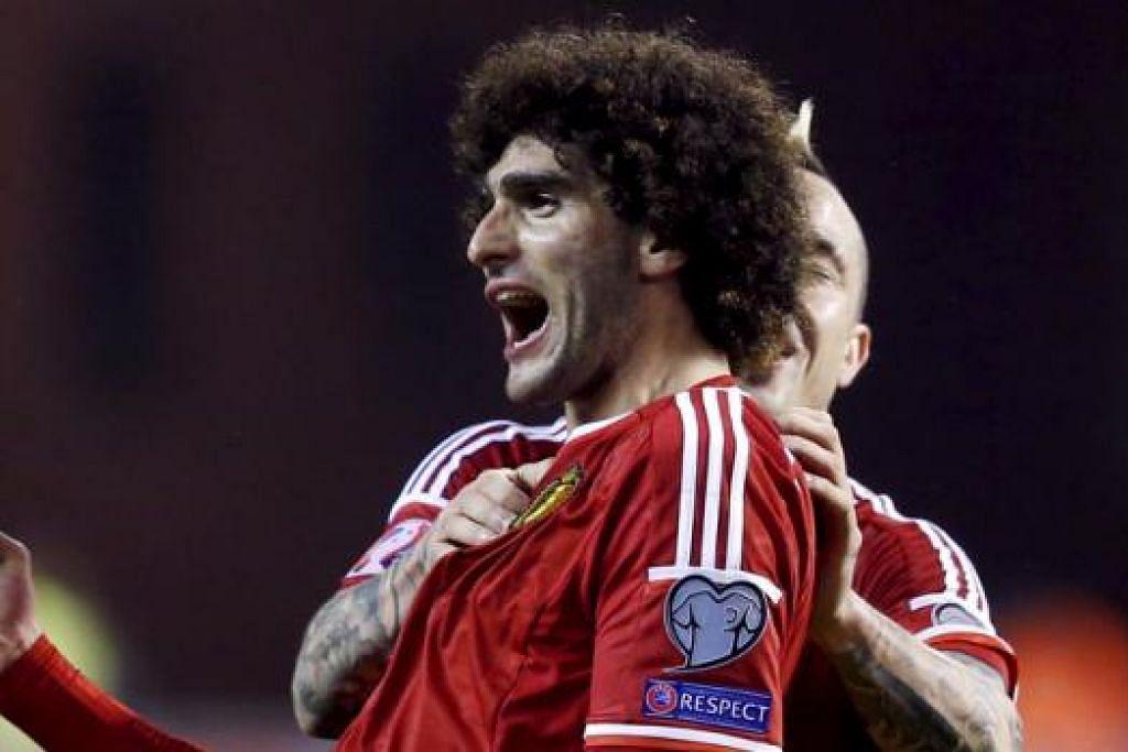 GOL: Pemain Manchester United Belgium, Marouane Fellaini, menjaringkan gol tunggal kemenangan negaranya ke atas Israel kelmarin. - Foto REUTERS