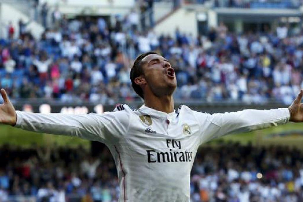 PENCAPAIAN LUAR BIASA: Tidak selalu seorang pemain itu dapat menyumbatkan lima gol sekali gus dalam satu perlawanan. Jadi beginilah reaksi bintang Real Madrid, Cristiano Ronaldo, semasa meraikan pencapaian hebatnya ketika menentang Granada kelmarin. - Foto REUTERS
