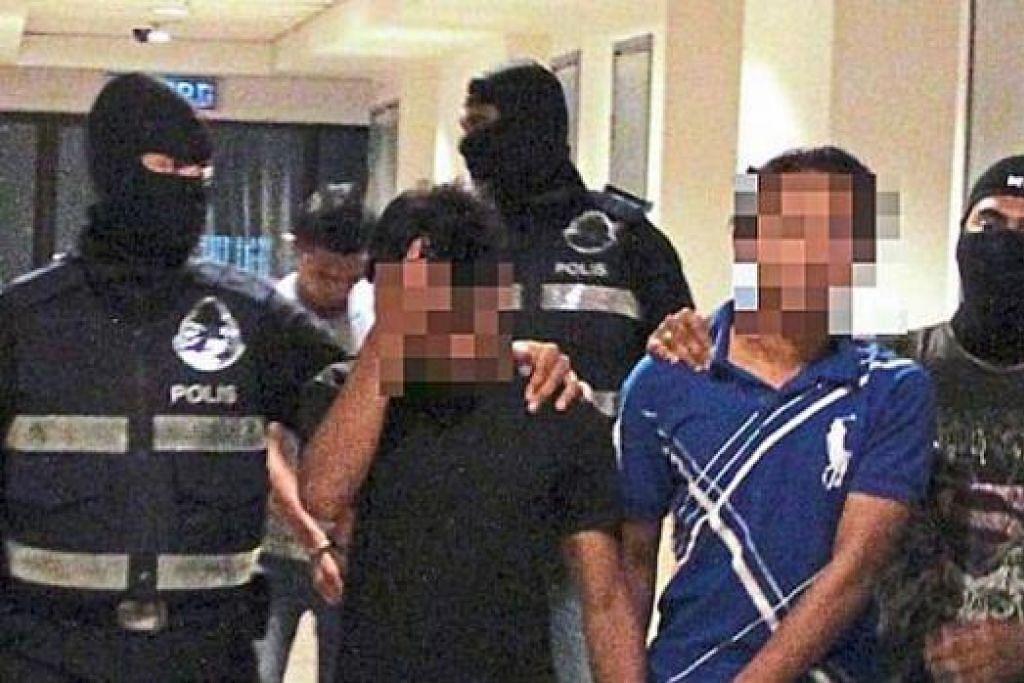 DITAHAN POLIS: Tiga militan yang ditahan oleh pegawai polis di Kedah dan Lembah Klang, Ahad lalu, sebelum mereka melakukan keganasan di Malaysia.- Foto THE STAR