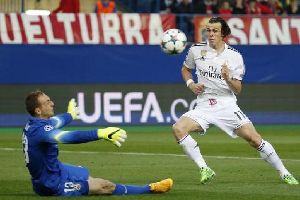 CEMERLANG: Penjaga gawang Atletico Jan Oblak bertindak cemerlang, menyelamatkan percubaan Bale di awal perlawanan.