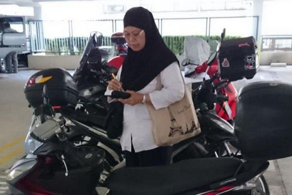 FAIL SAMAN: Cik Rukinah tidak tergesa-gesa memfailkan saman kepada pemandu yang melanggar peraturan. – Foto HAKIM YUSOF
