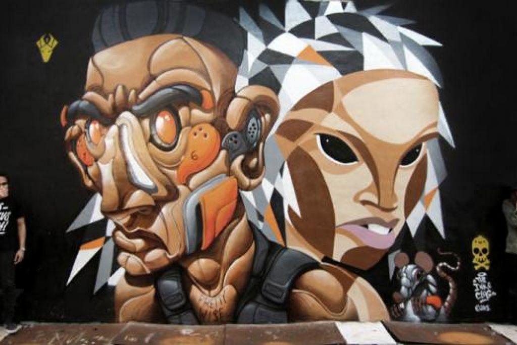 GABUNGAN DUA ARTIS GRAFITI: Encik Eman dan Cik Nadirah kerap mendapat undangan melukis tembok di pelbagai kota seperti Sydney, Melbourne, Osaka, London dan Perancis. - Foto INK & CLOG