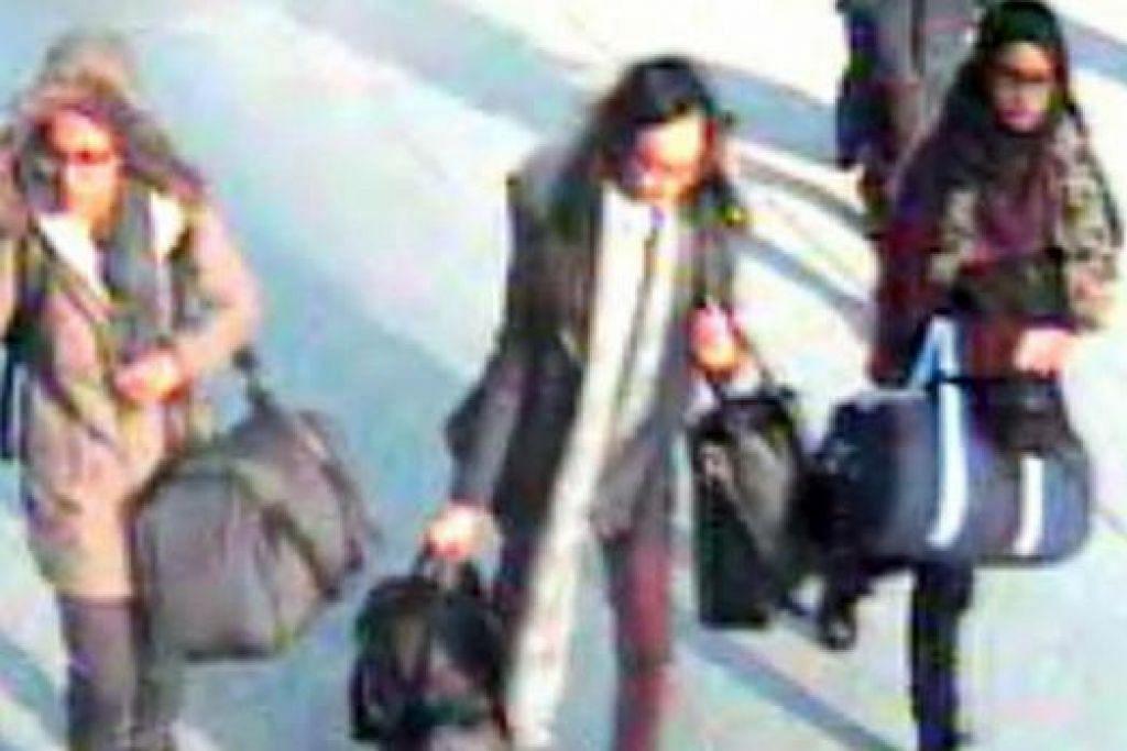 SERTAI ISIS: (Dari kiri) Amira Abase, Kadiza Sultana dan Shamima Begum, yang dipercayai menyertai kumpulan militan ISIS di Syria, di Lapangan terbang Gatwick sebelum mereka berangkat ke Syria melalui Turkey. - Foto METROPOLITAN POLICE