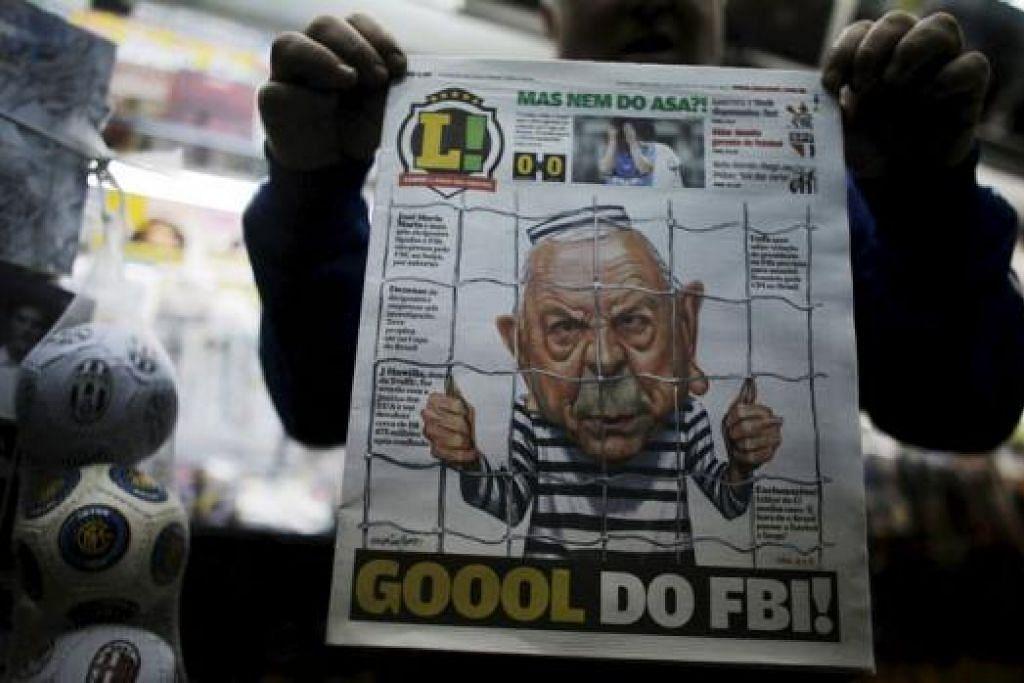 TUMPUAN PADA FIFA: Sebuah akhbar Brazil menunjukkan lukisan karikatur mantan presiden Gabungan Bola sepak Brazil, Jose Maria Marin, dalam penjara, dengan tajuk 'Gol bagi FBI'. Polis Brazil telah memulakan siasatan tentang dakwaan penerimaan rasuah dalam industri bola sepak negara itu. - Foto REUTERS
