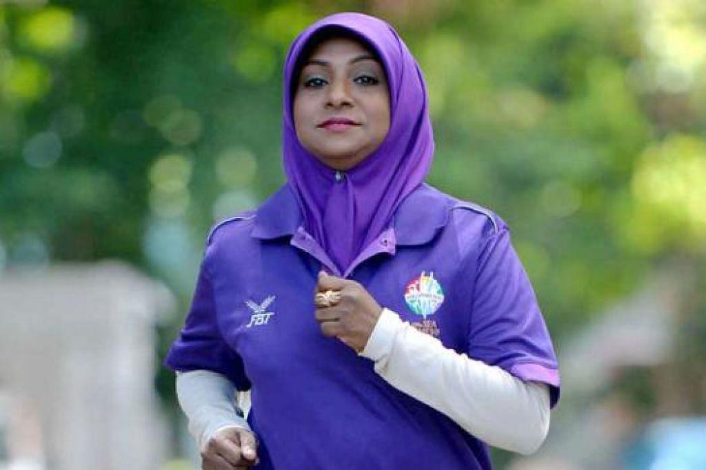 CIK ASMA: Dijangka bawa obor sejauh 280 meter. Cik Asma bangga dapat mewakili kaum Muslimah dan ibu dalam Larian Obor Sukan Sea ke-28. - Foto MOHD KHALID BABA