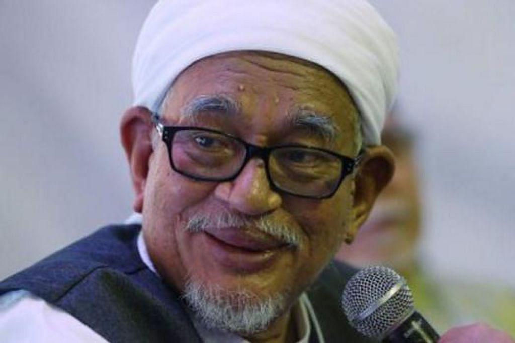 MENANG: Datuk Seri Hadi mengekalkan jawatannya sebagai Presiden PAS