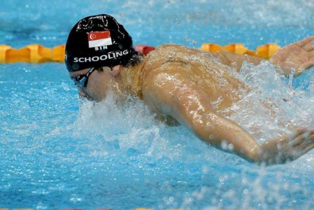 KEMENANGAN HEBAT: Jaguh renang, Joseph Schooling, meraikan kemenangan bersejarah dalam acara 50 meter gaya bebas di Sukan SEA semalam. - Foto AFP