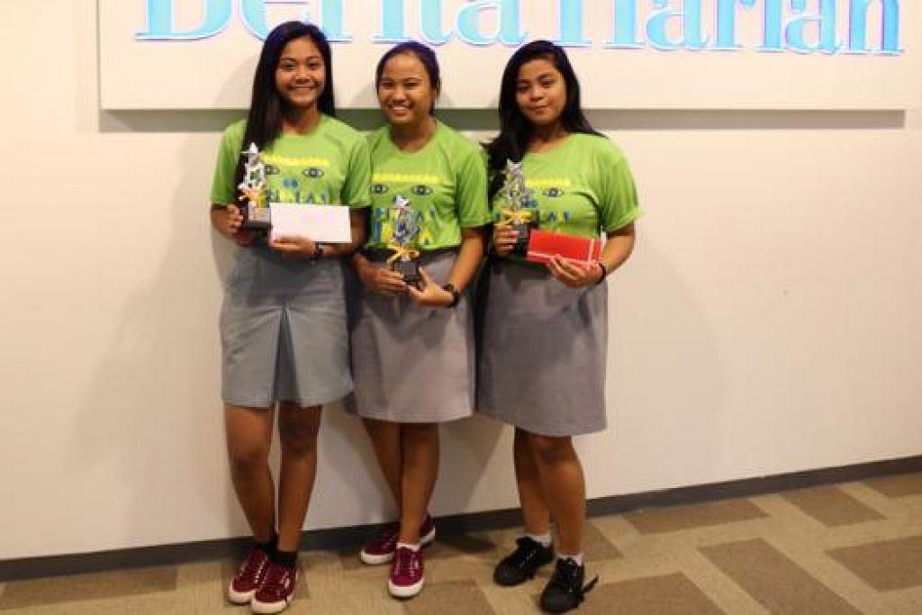 LEBIH BAIK TAHUN INI: Pelajar Sekolah Menengah Teck Whye - (dari kiri) Nurul Marsya Rahmat, Nurul Aisyah Mohamed Din dan Nurul Syafiqah Suzairi - memperbaiki kedudukan mereka dengan memenangi tempat kedua dalam Kem Obor tahun ini.