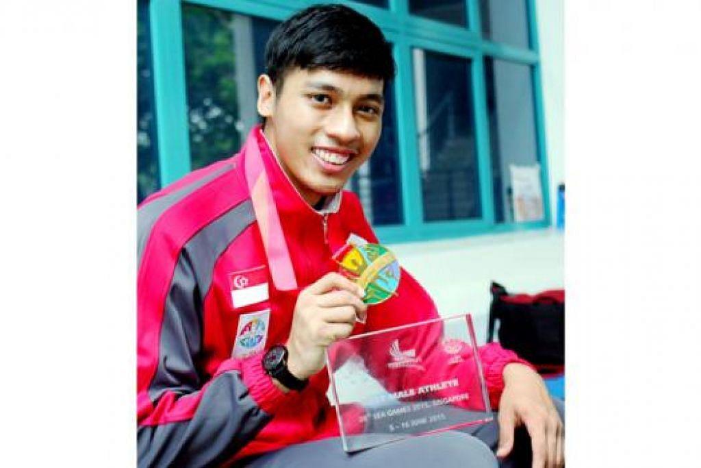 JUARA BERTAHAN: Pesilat nasional Muhammad Nur Alfian Juma'en meraih pingat emas dalam Kelas F - acara yang turut dimenanginya di Sukan SEA Myanmar dua tahun lalu. - Foto NORMAN SAWI
