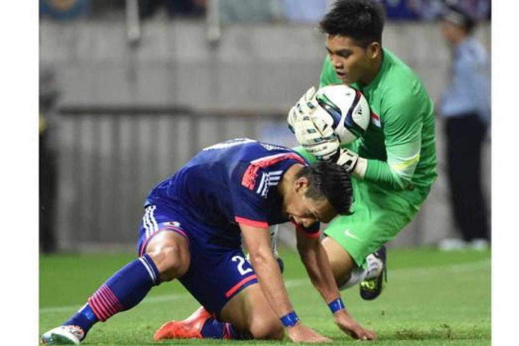 TERLALU PERKASA: Aksi cemerlang Izwan Mahbud di Stadium Saitama dijangka menarik perhatian kelab asing. - Foto AFP