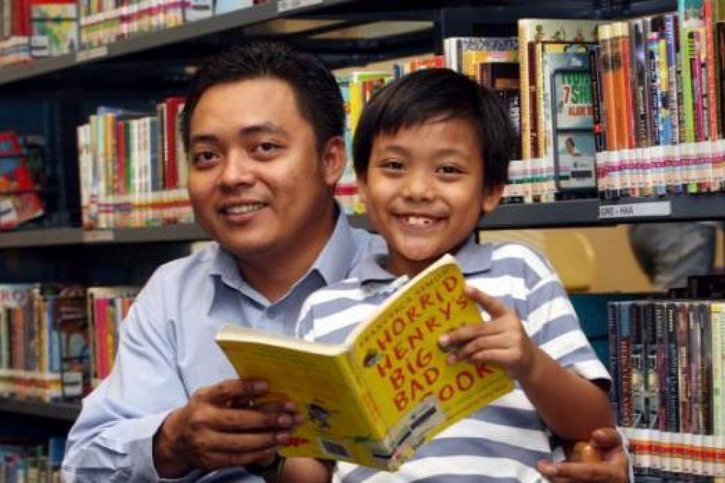 ANAK DAN BAPA BACA BUKU: Sering ada kempen nasional yang menggalakkan ibu bapa memupuk anak agar suka membaca buku. - Foto hiasan