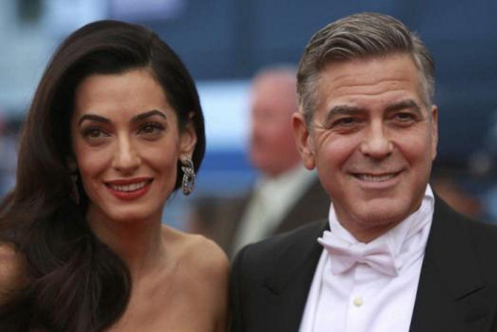 TERUS OPTIMISTIK: Biarpun usia meningkat, George Clooney, 54 tahun, yang sudah bergelar suami kepada Amal Alamuddin (kiri) berasa cukup optimistik dan bertuah dengan kehidupannya selama ini. - Foto REUTERS