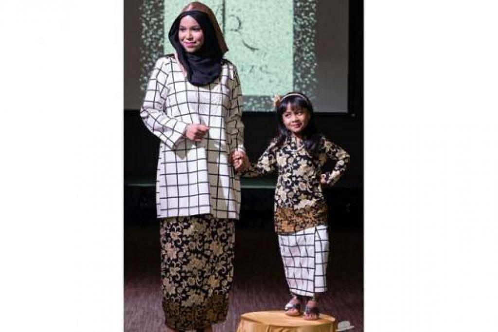MODEN DAN TRADISIONAL: Baju kurung moden bermotifkan batik 'royale' ini adalah antara koleksi Hari Raya bagi kaum ibu dan anak perempuan di bawah jenama Aly Rizq - hasil sentuhan pereka fesyen setempat, Cik Zeryn Mohd, yang juga penganjur bersama acara pertunjukan fesyen 'Dare to Dream: Start Local Go Global'. - Foto BLISSFUL STUDIOS