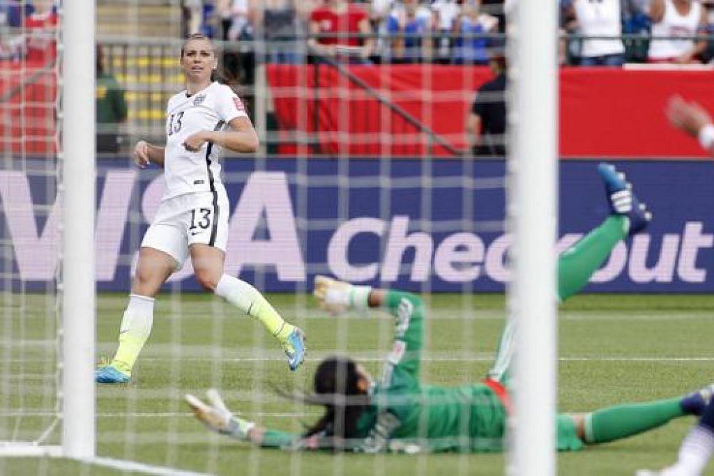 GOL: Penyerang Amerika Syarikat, Alex Morgan (jersi 13), menjaringkan gol untuk pasukannya ketika menewaskan Colombia 2-0 di kejohanan Piala Dunia wanita. - Foto REUTERS