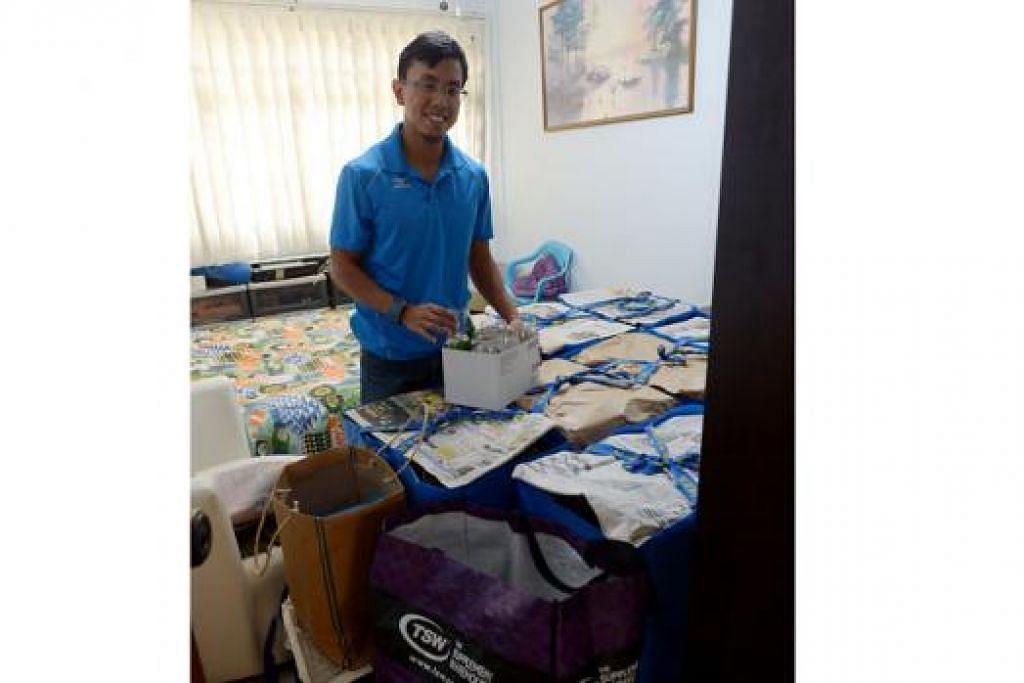 KESIBUKAN BARU: Kalau sebelum Sukan SEA Muhammad Amirudin berlatih gigih untuk memenangi pingat, beliau kini sibuk memastikan semua urusan pembelian barang dan persiapan perkahwinannya pada 8 Ogos ini tersusun rapi. - Foto TUKIMAN WARJI