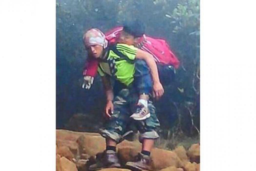 ENCIK RIZUAN KAUHININ: Menganggap tindakannya menggendong seorang pelajar Singapura sejauh beberapa kilometer demi menyelamatkan nyawa budak itu sebagai satu tanggungjawab dan bukan tindakan hero. - Foto FACEBOOK