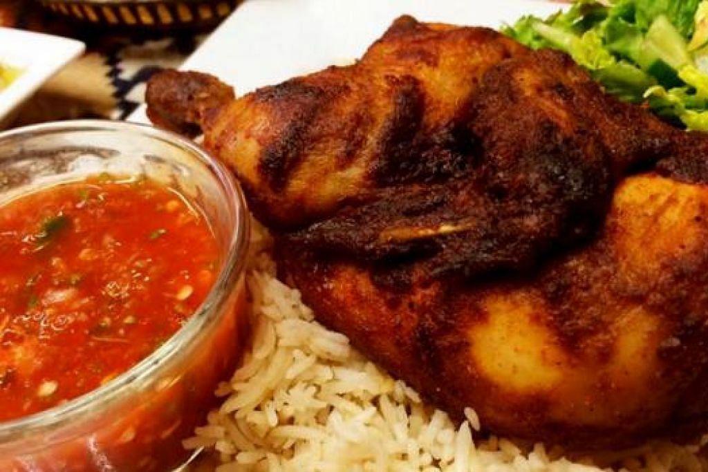 KABSA RICE CHICKEN: Ayam yang dipotong separuh dan digoreng hingga rangup dengan isi lembut di dalam amat berperisa dengan rempah ratus Maghribi yang eksotik dan lazat. - Foto-foto KULINARY AFFAIRS