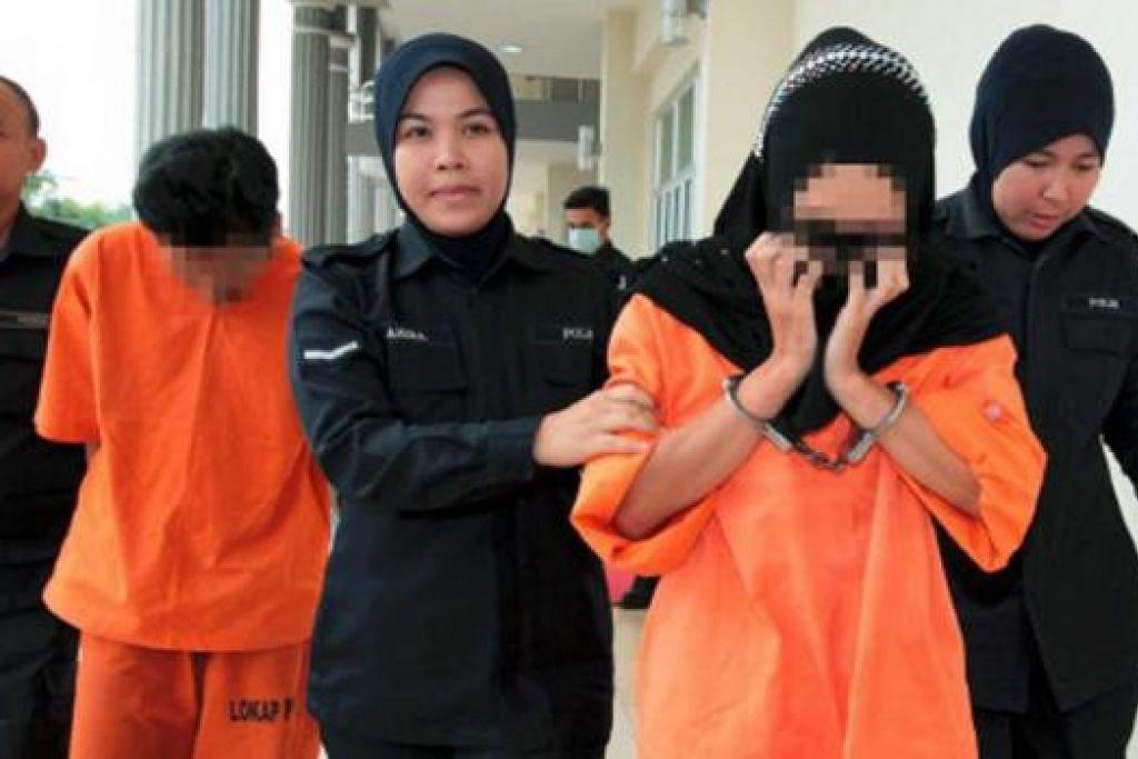 DITAHAN: Pasangan yang mendera Nur Zuliana ditahan semasa di restoran. - Foto BHM