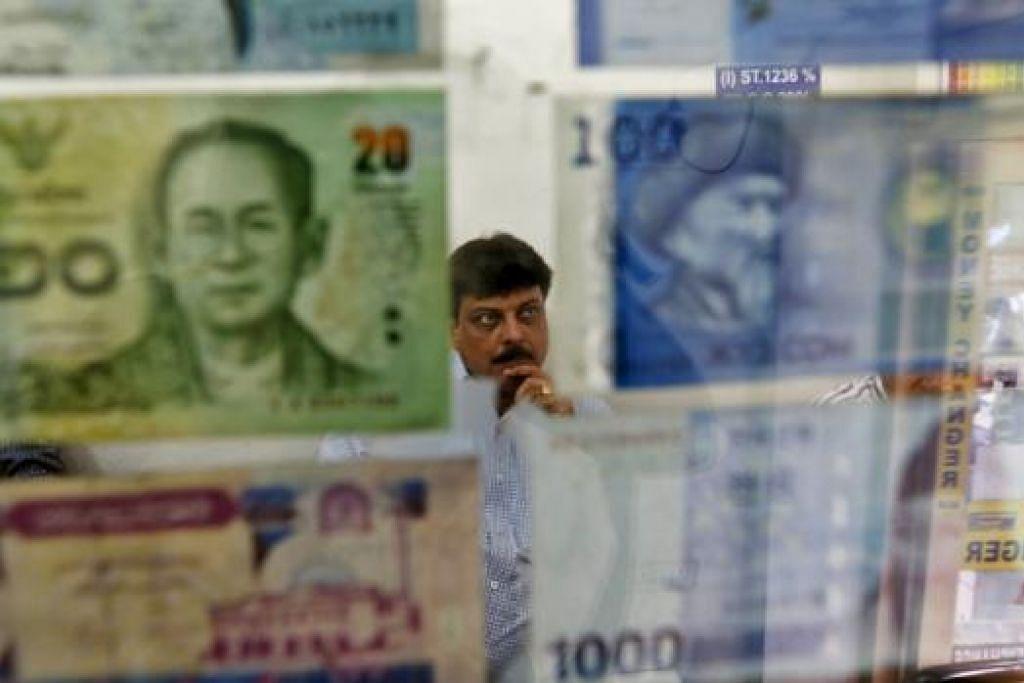 PERKUKUH NILAI MATA WANG: Bank Indonesia berkata pihaknya akan menawarkan pengecualaian penggunaan mata wang rupiah bagi urus niaga domestik dalami kes-kes tertentu. - Foto REUTERS