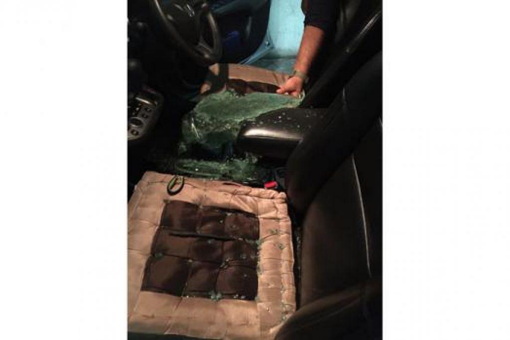 TAK SANGKA JADI MANGSA: Tingkap kereta Honda Stream milik Cik Sarwani dipecah dan stereo keretanya dicuri semasa diletakkan di tempat meletak kereta Plaza Angsana. - Foto ihsan SARWANI SAHIR