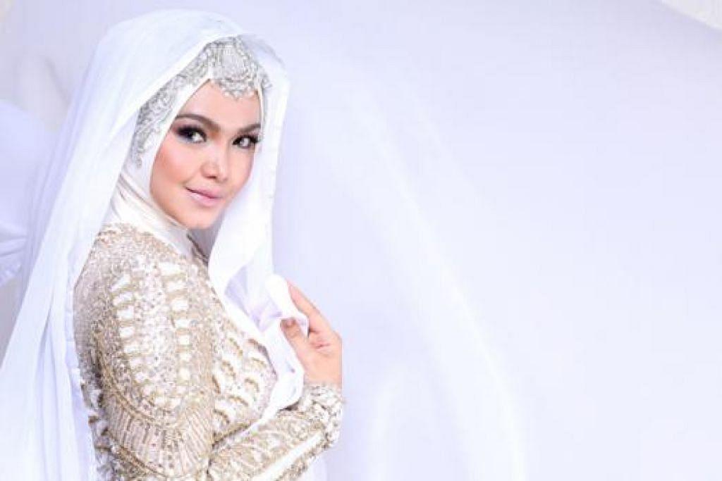 LANCAR ALBUM BARU: Siti baru melancarkan album 'Unplugged Siti Nurhaliza' baru-baru ini. - Foto SNP (M) SDN BHD