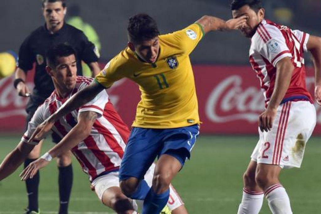PEMAIN BERPOTENSI: Penyerang Brazil Firmino (tengah) yang menyertai Liverpool dari Hoffenheim dijangka membentuk gandingan mengancam dengan Philippe Countinho. - Foto AFP