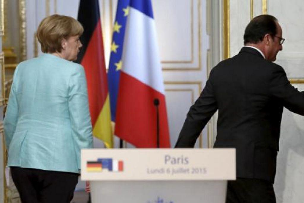 BERI KATA DUA: Presiden Perancis, Encik Francois Hollande, dan Canselor Jerman, Cik Angela Merkel, beredar selepas mesyuarat kecemasan Kesatuan Eropah yang telah membincangkan isu Greece. - Foto REUTERS
