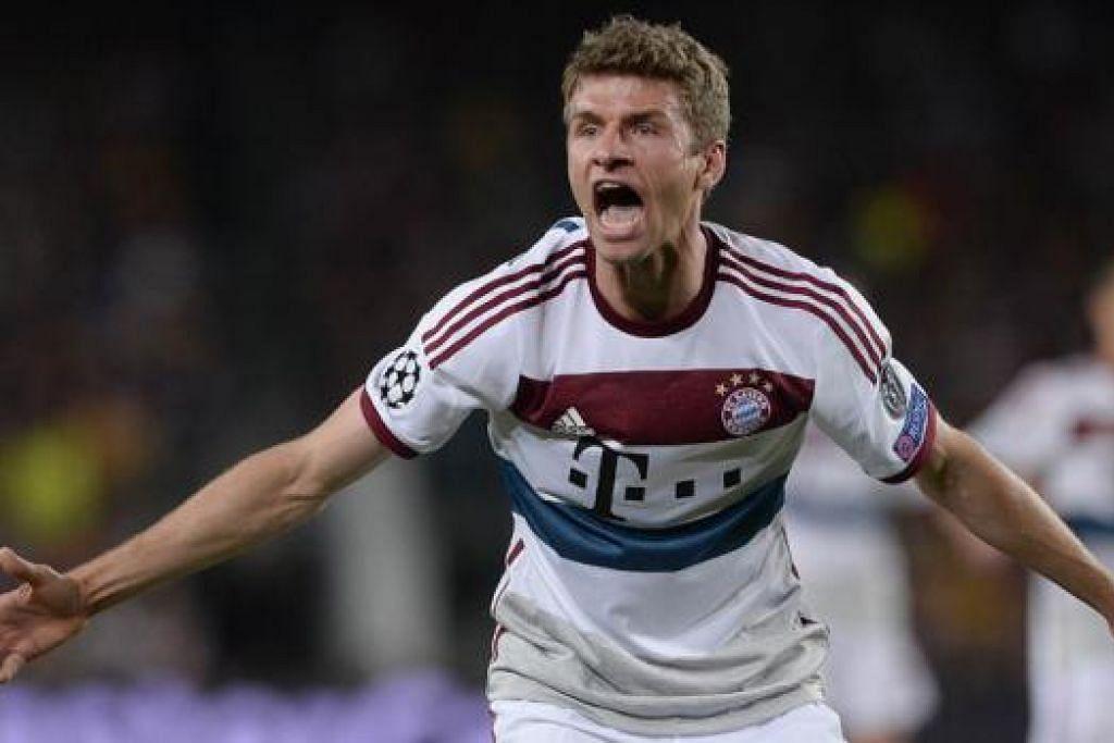 DIBURU: Penyerang Bayern Munich, Thomas Muller, mungkin menjadi pemain Manchester United musim depan. - Foto AFP