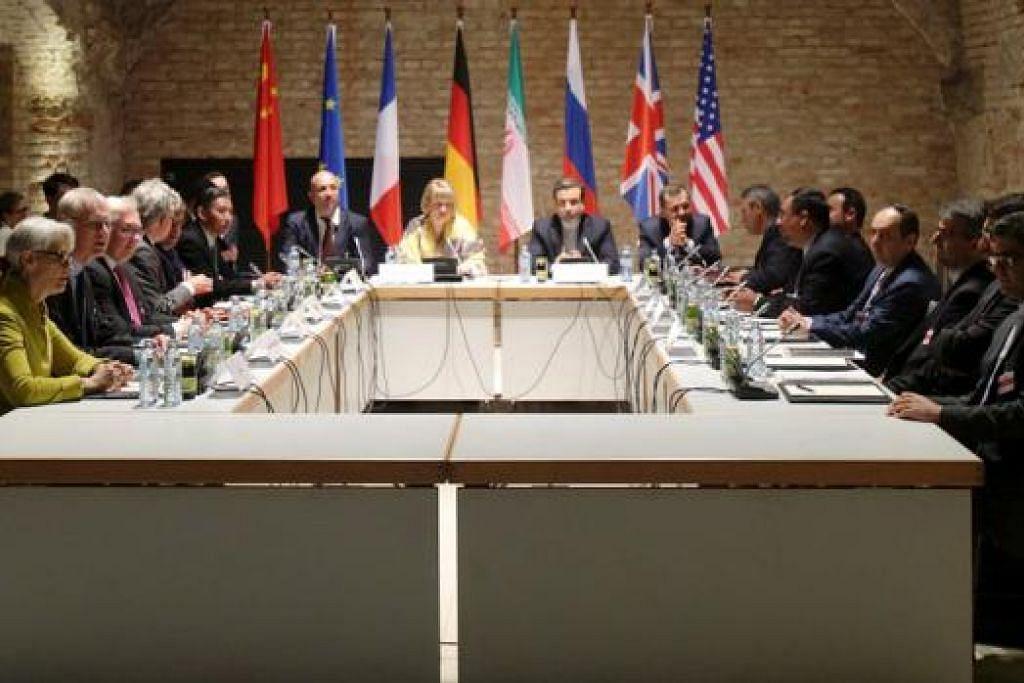 BERUNDING: Para perunding Iran dan enam kuasa besar dunia mengadakan perbincangan mengenai isu program nuklear Iran di Hotel Palais Coburg di Vienna. - Foto REUTERS